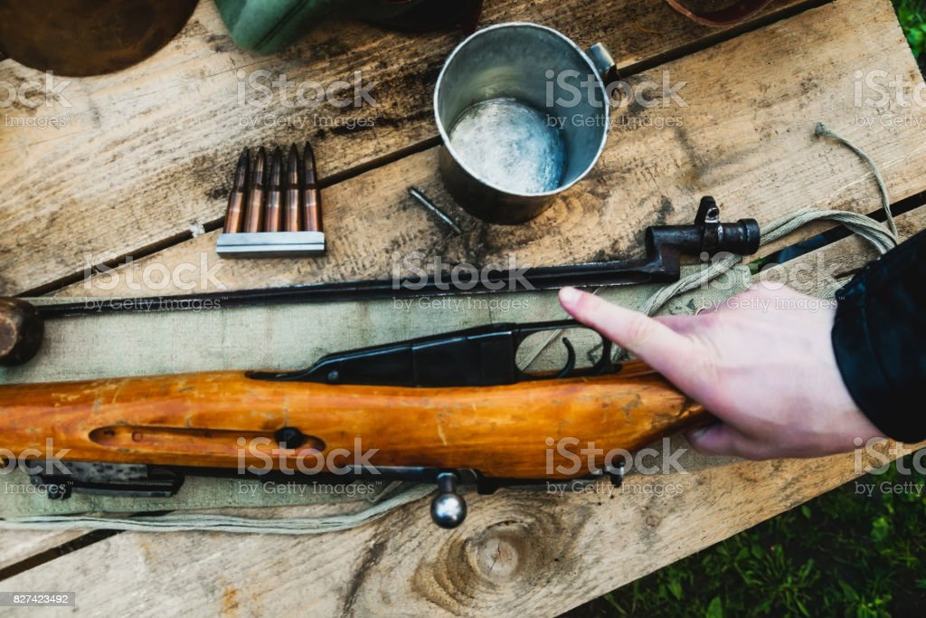 Arm takes a rifle stock photo
