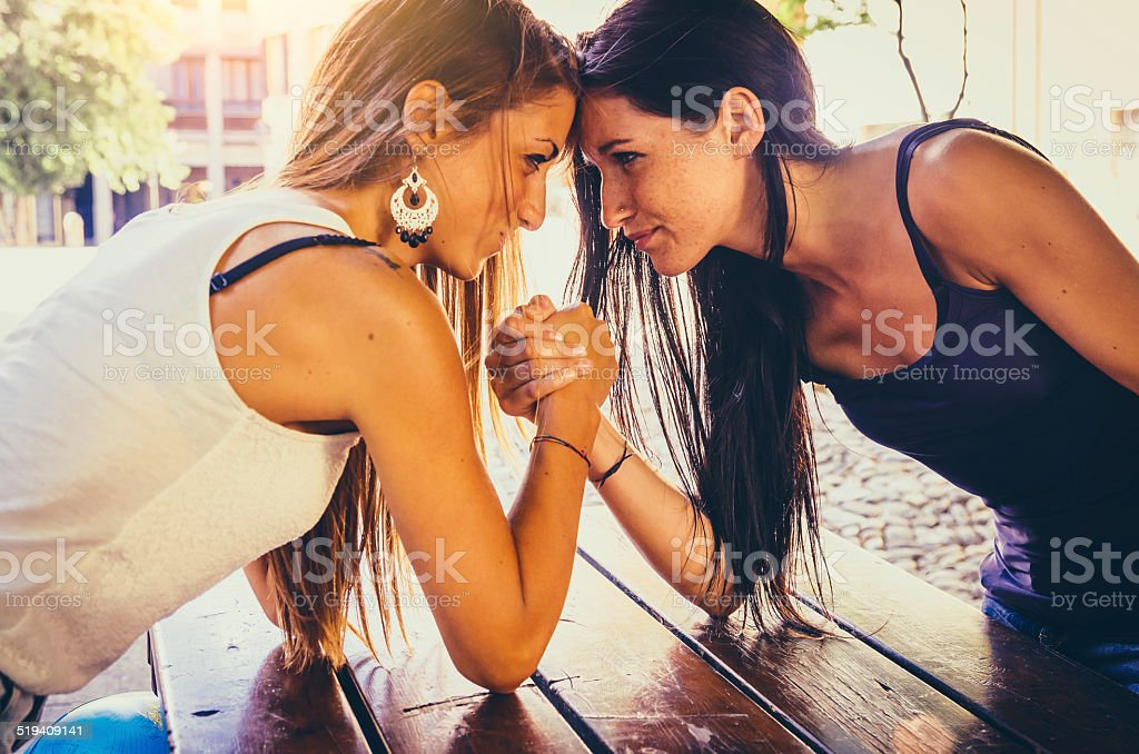 Arm Wrestling Between Two Beautiful Young Women stock photo