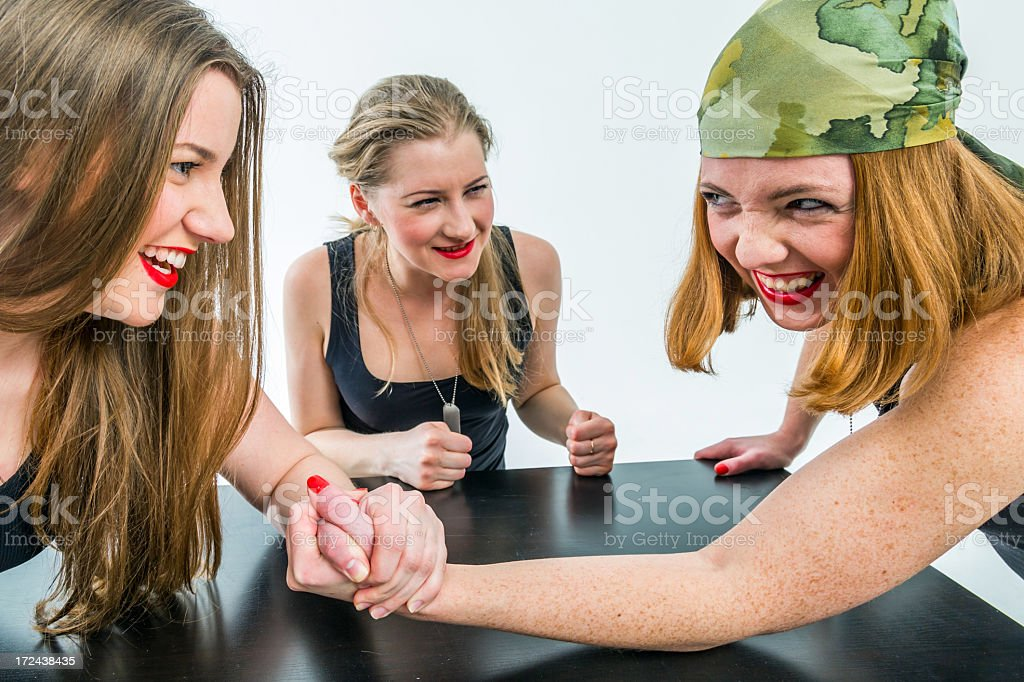 Arm wrestling for military women royalty-free stock photo