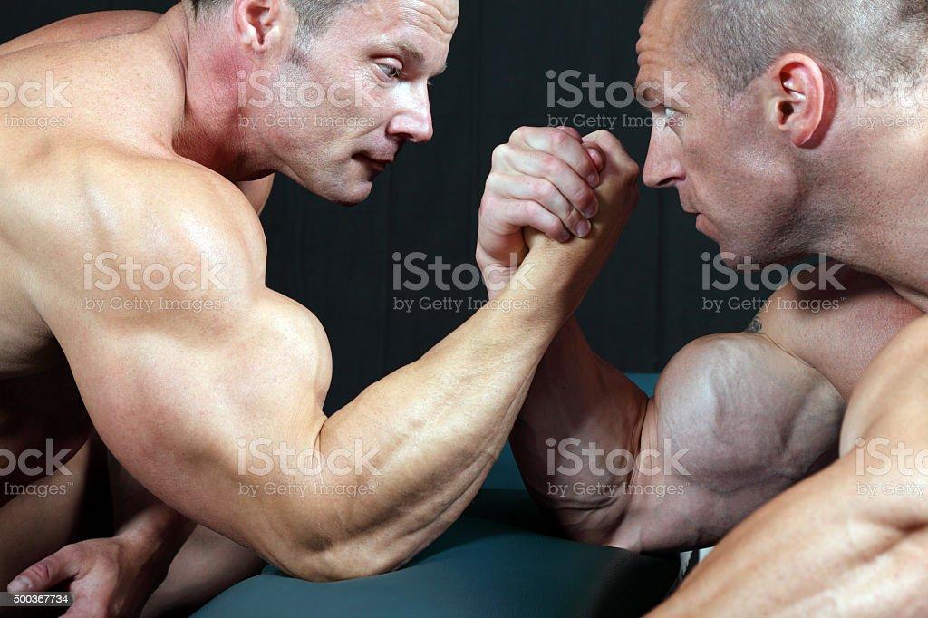 Arm wrestling stock photo