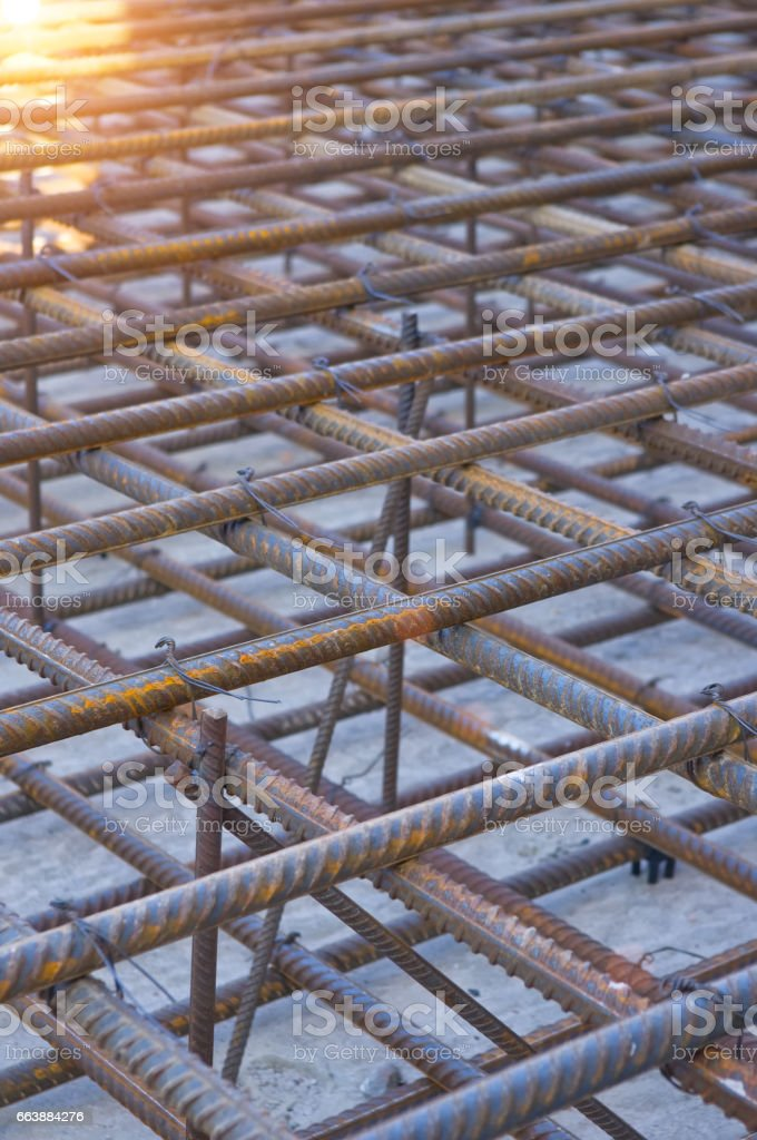 Armature is tied under the concrete foundation stock photo