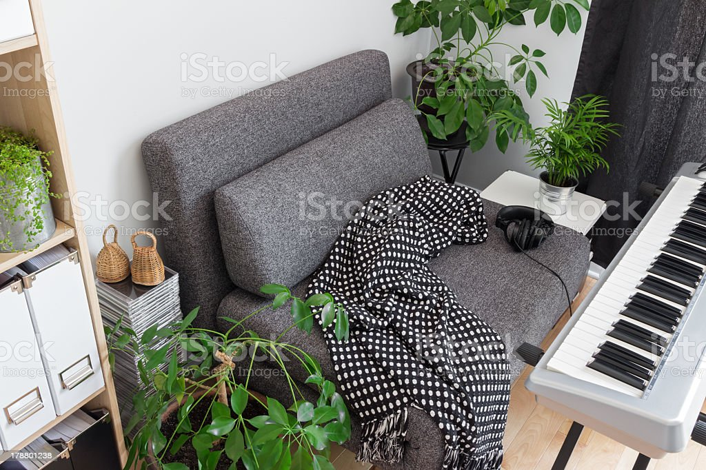 Armchair and electric piano in a musician's home stock photo