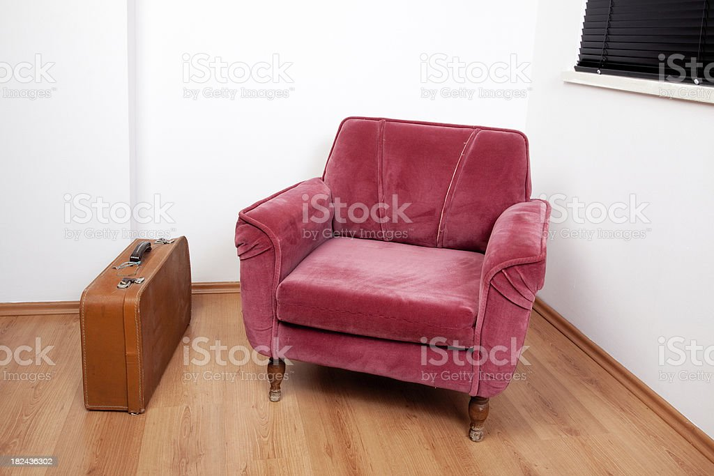 armchair and suitcase royalty-free stock photo