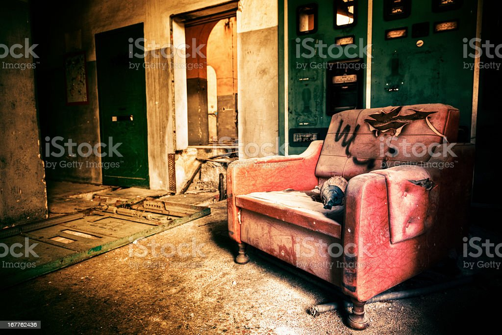 Armchair in a Ruined Building stock photo