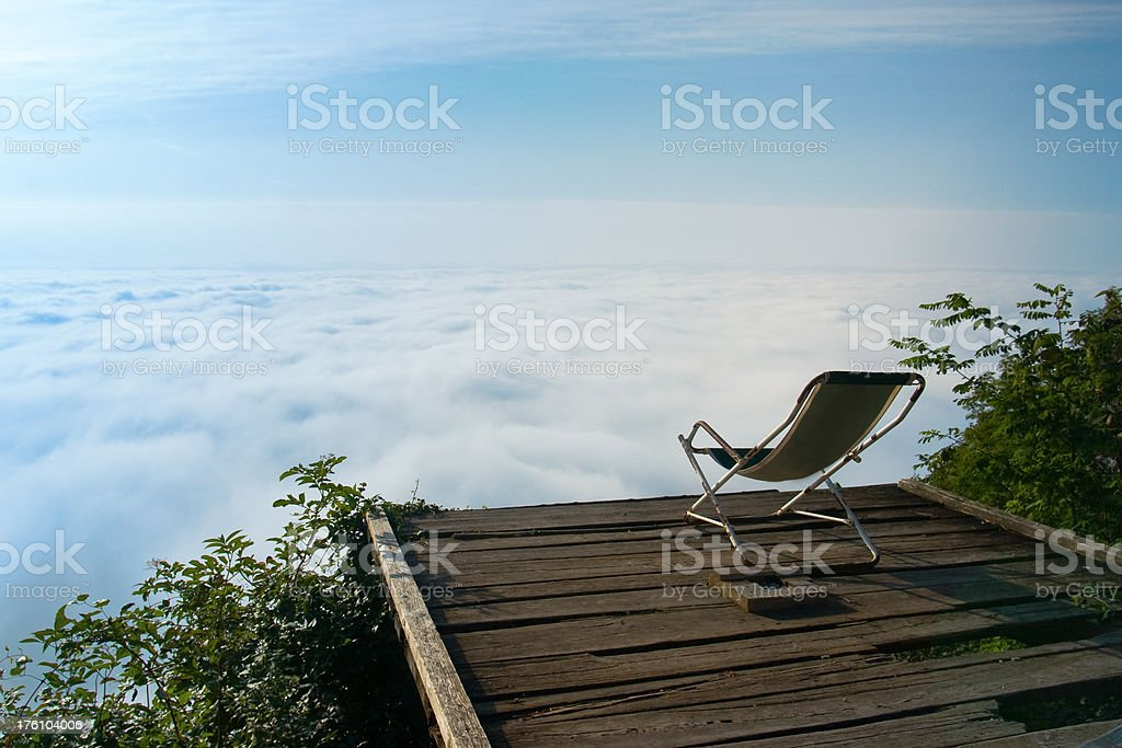 Armchair in clouds royalty-free stock photo