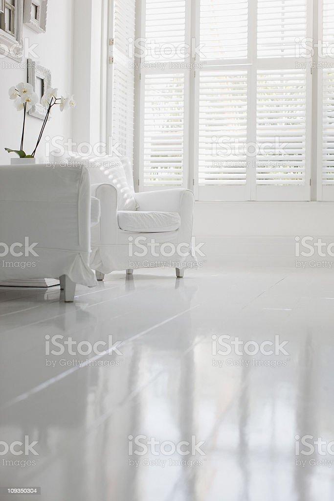 Armchair in elegant white living room stock photo