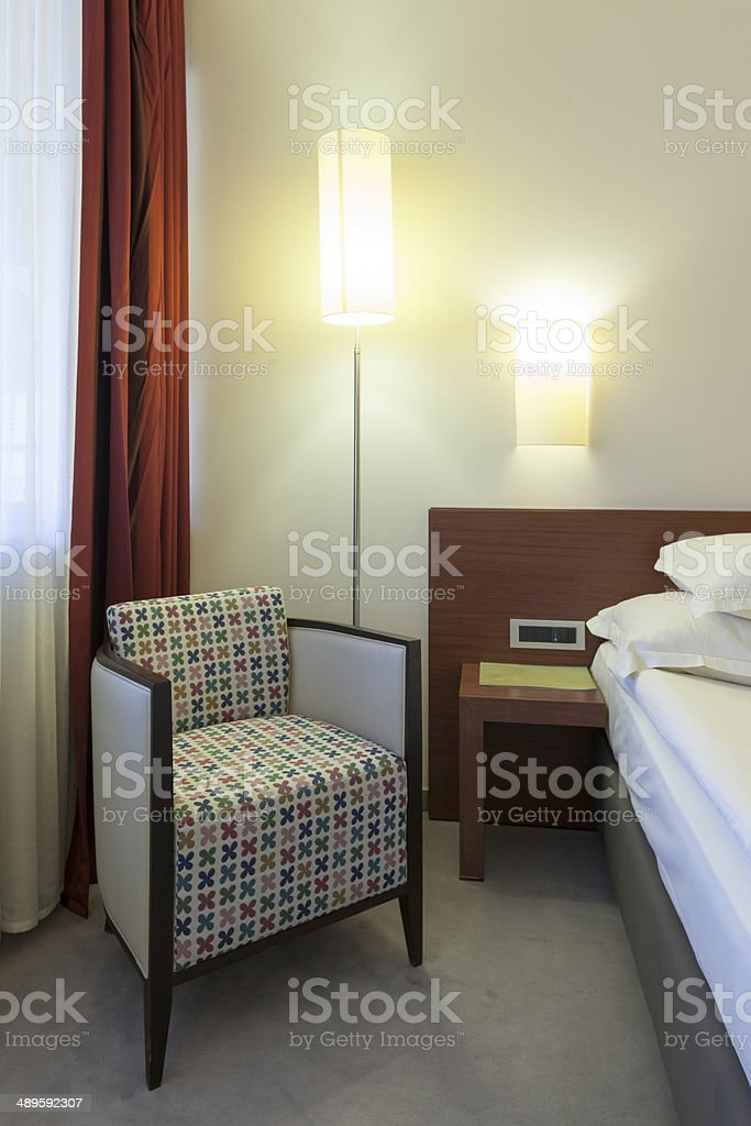 Armchair in hotel bedroom royalty-free stock photo