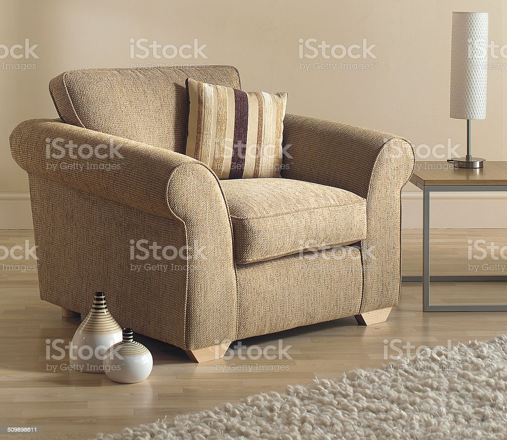 Armchair in interior of Traditional Livingroom / lounge \tArmchair in interior of Traditional Livingroom / lounge stock photo
