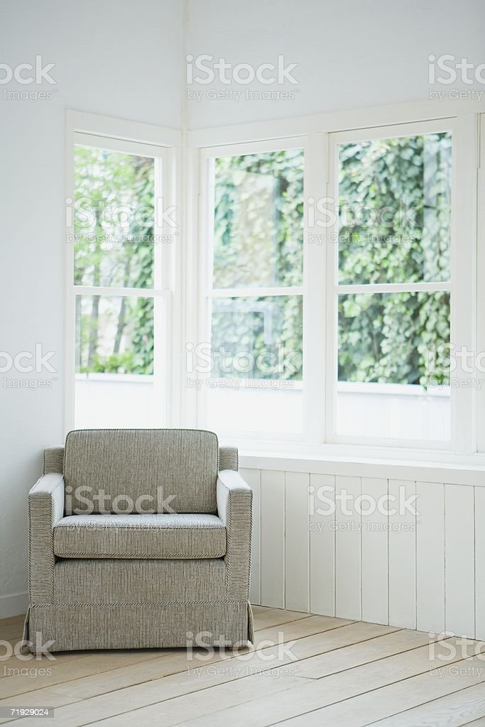 Armchair in the corner of a room stock photo