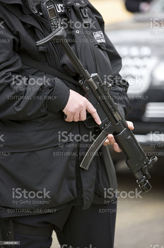 Armed British Police Officer at London funeral of Baroness Thatcher stock photo