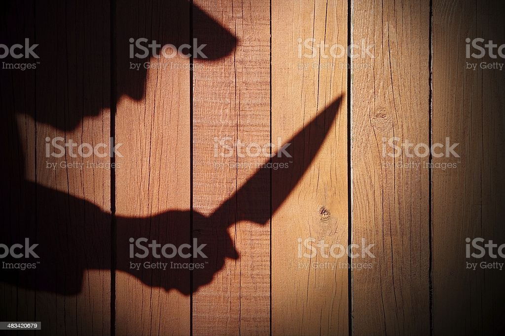 Armed Criminal Man Silhouette on natural wooden background, XXXL stock photo