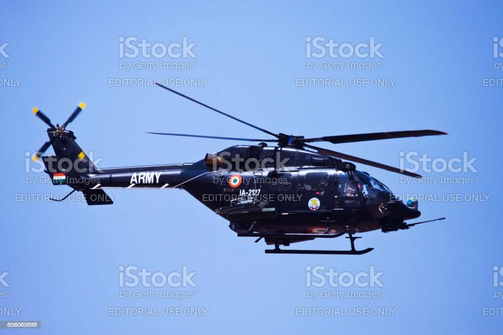 Armed Dhruv flying at Aero India stock photo