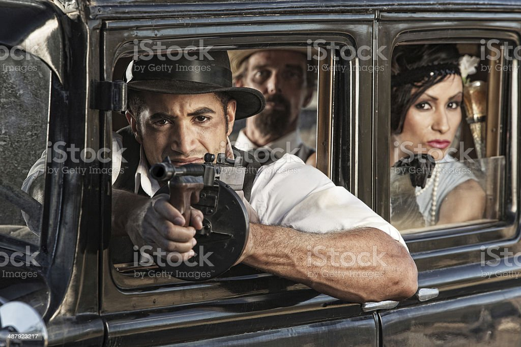 Armed Ganster Shooting from Car stock photo