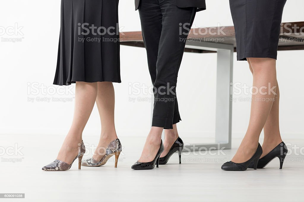 Armed in professional skills and high heels stock photo
