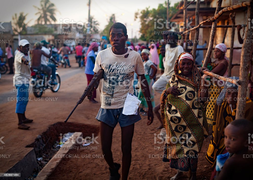 Armed man during a Renamo electoral rally in Angoche stock photo
