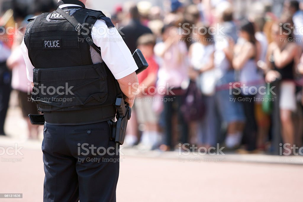 Armed Police Officer outside Buckingham Palace stock photo