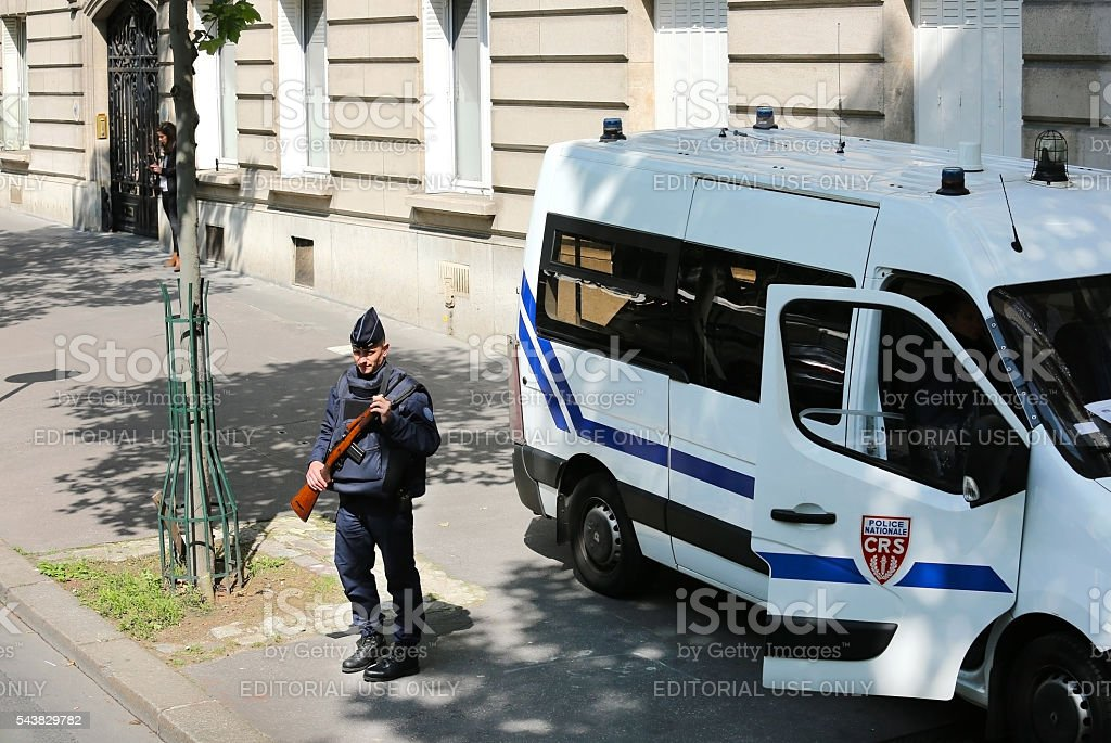 Armed policeman on the streets of Paris stock photo