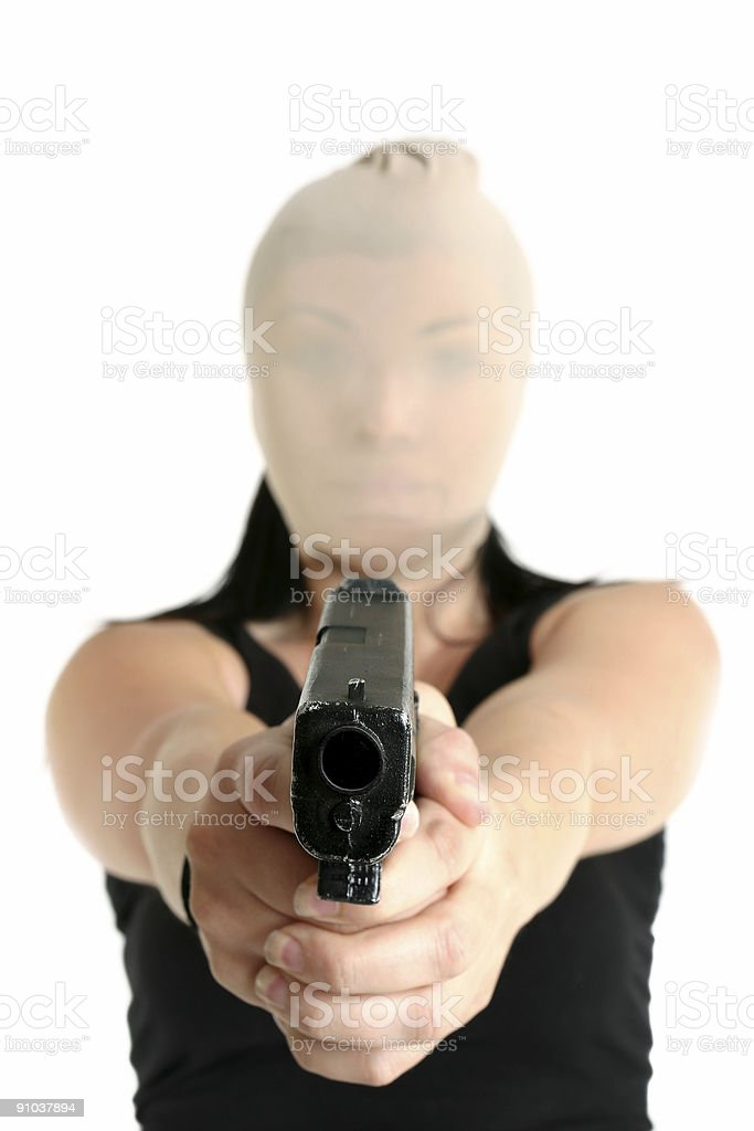 Armed robber with gun royalty-free stock photo