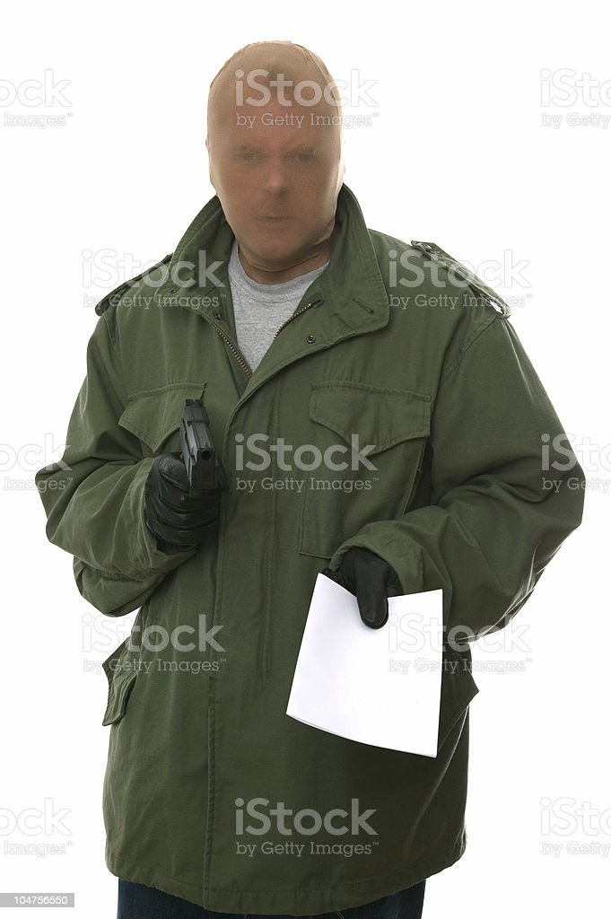 Armed robber with note. royalty-free stock photo