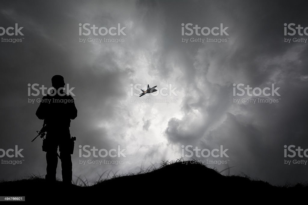 Armed Soldier Left All Alone stock photo