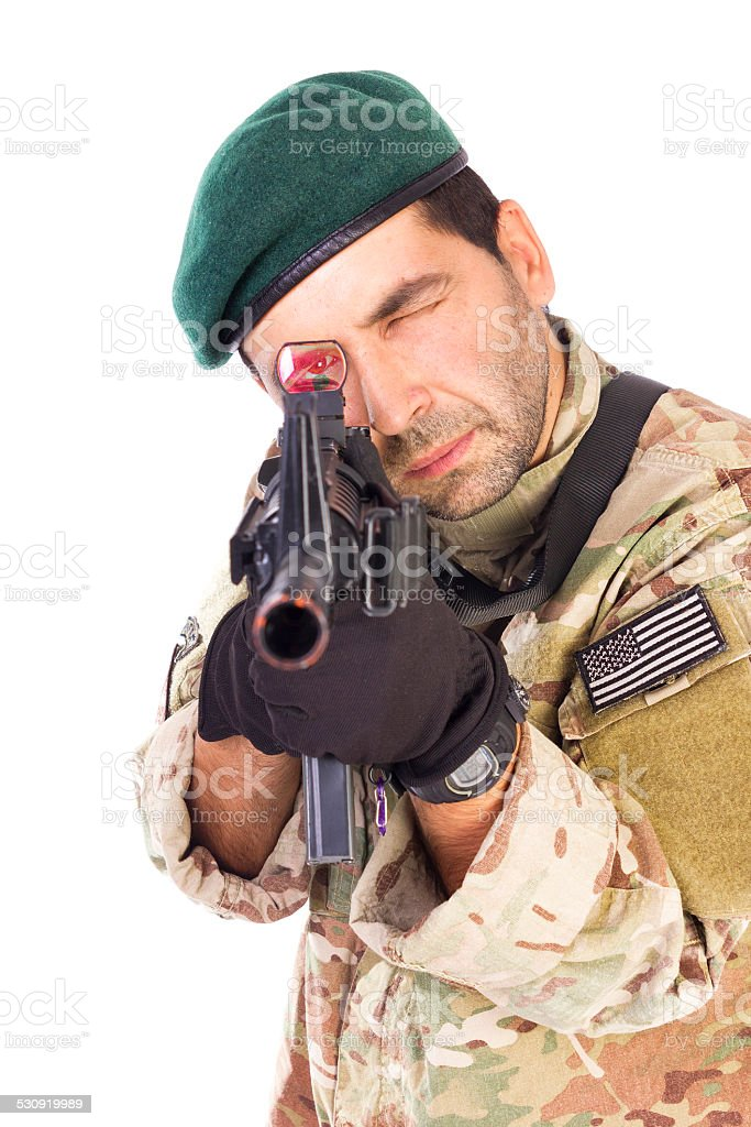 Armed soldier pointing a riffle M4 stock photo