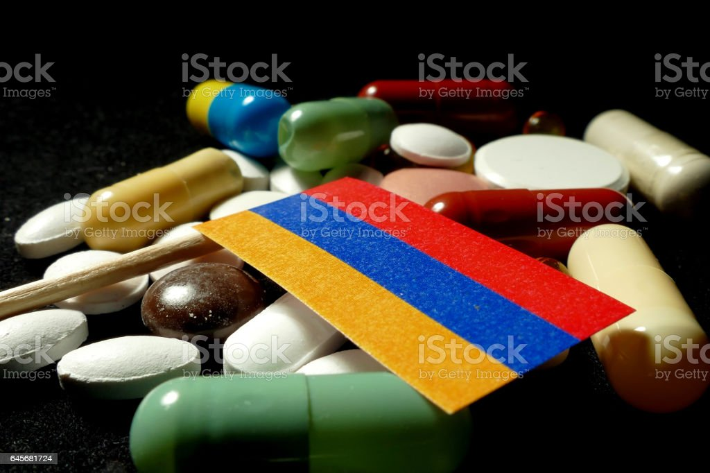 Armenian flag with lot of medical pills isolated stock photo