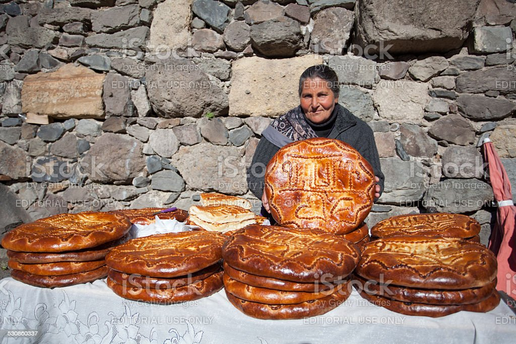 Armenian woman selling traditional cake stock photo