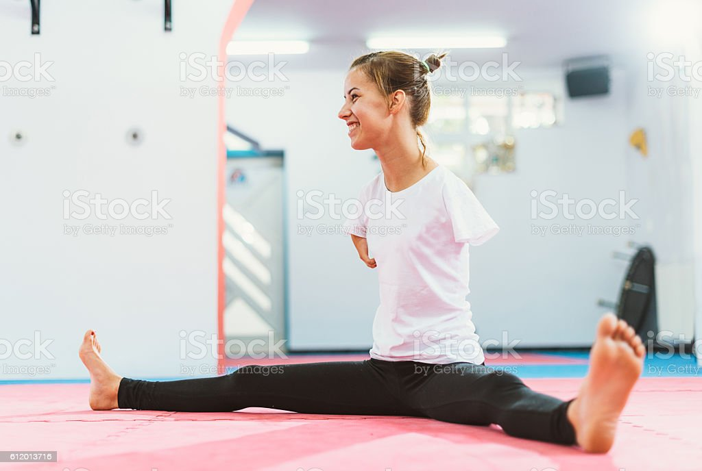 Armless sportsman warming up for martial arts training stock photo