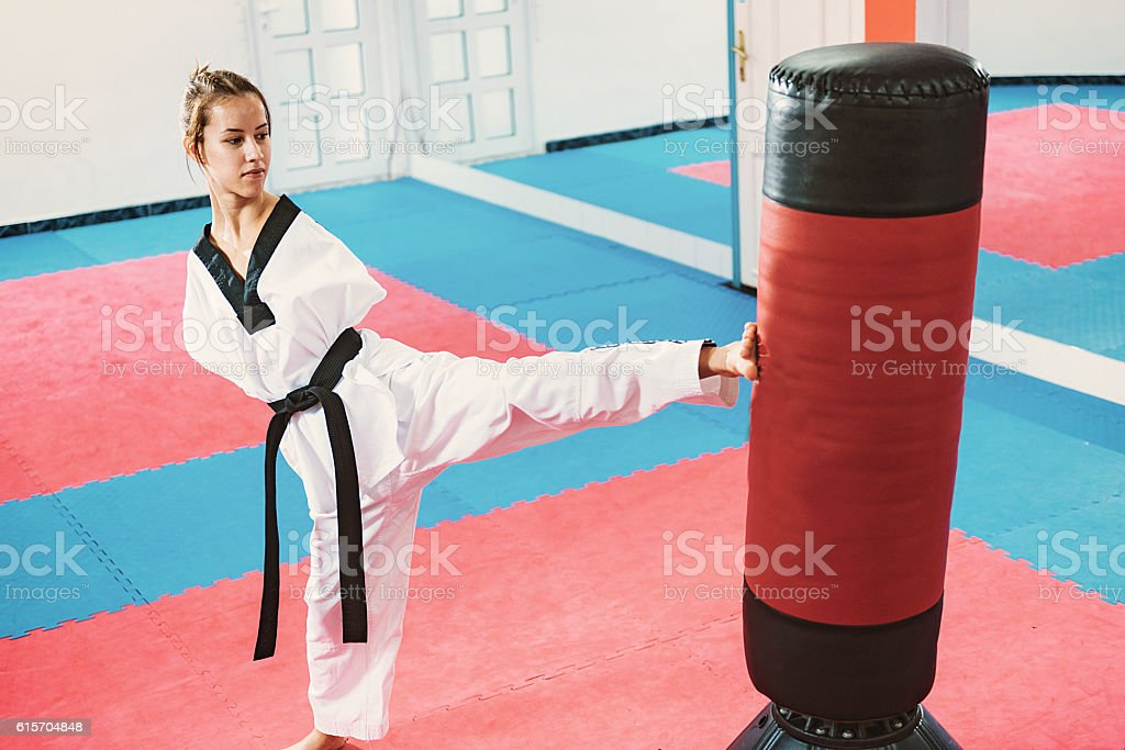 Armless young woman practicing taekwondo stock photo