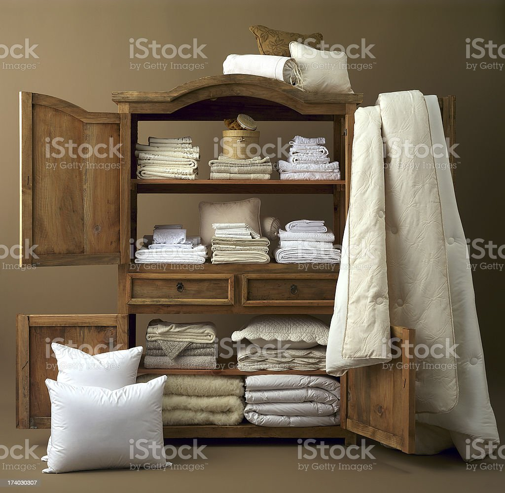 Armoire with linens stock photo