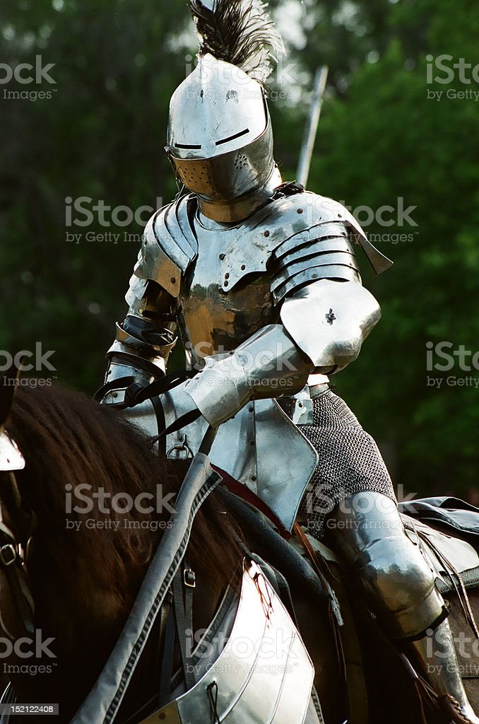 Armored Knight suited up for battle stock photo