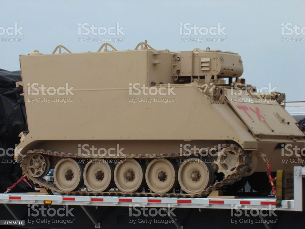 Armored tank in tow stock photo