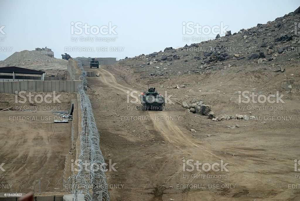 Armored vehicles by boundary wall stock photo