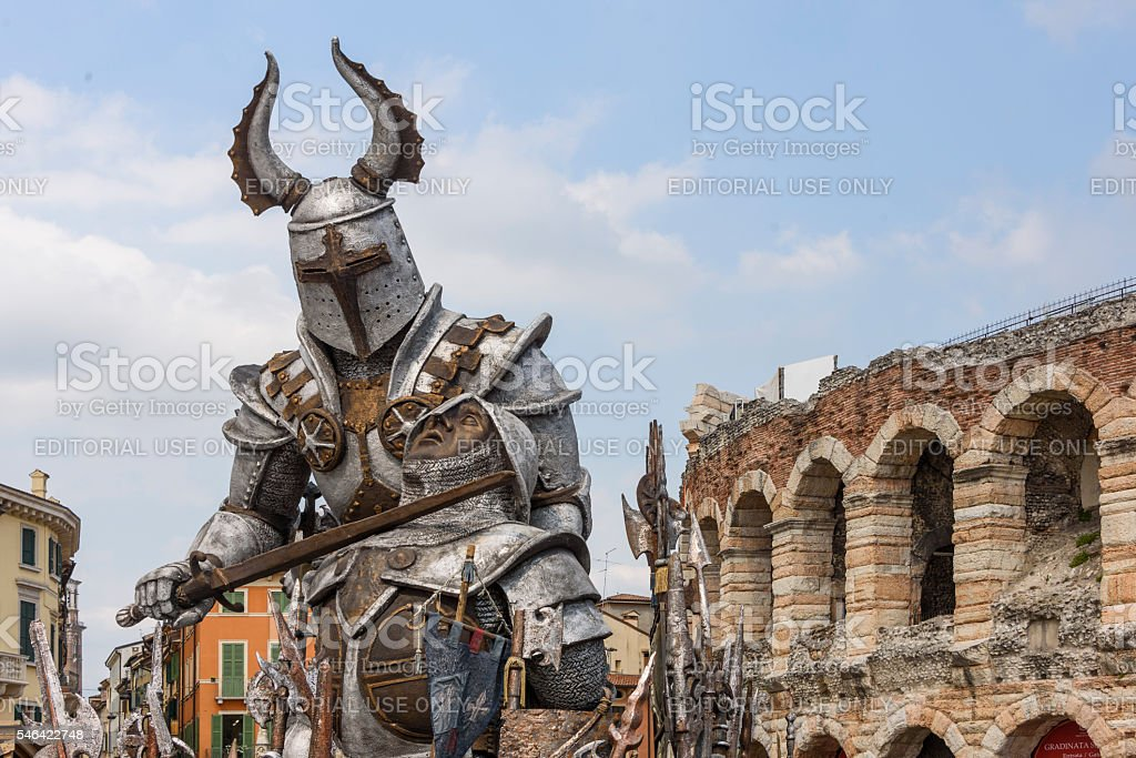 Armoured knight depicted in front  of the Arena di Verona stock photo
