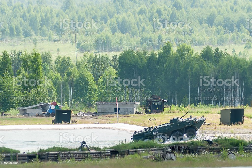 BTR-82A armoured personnel carrier exits from water stock photo
