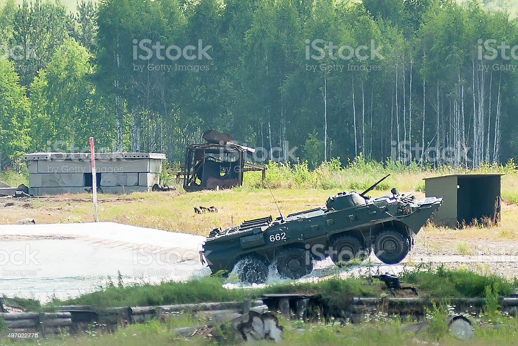 BTR-82A armoured personnel carrier goes from water stock photo