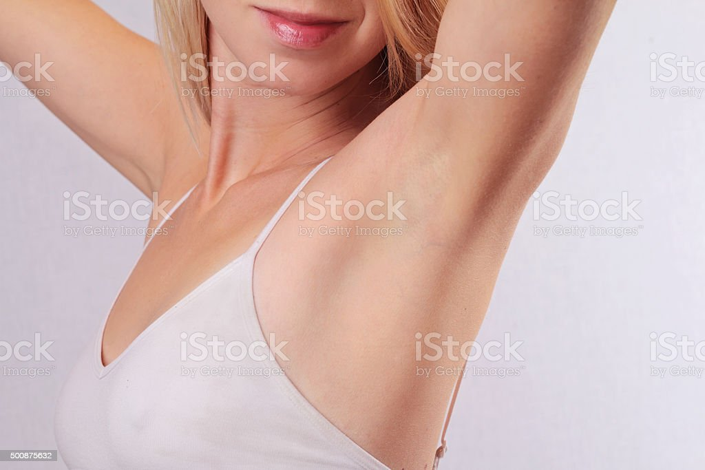 Armpit epilation, lacer hair removal. stock photo
