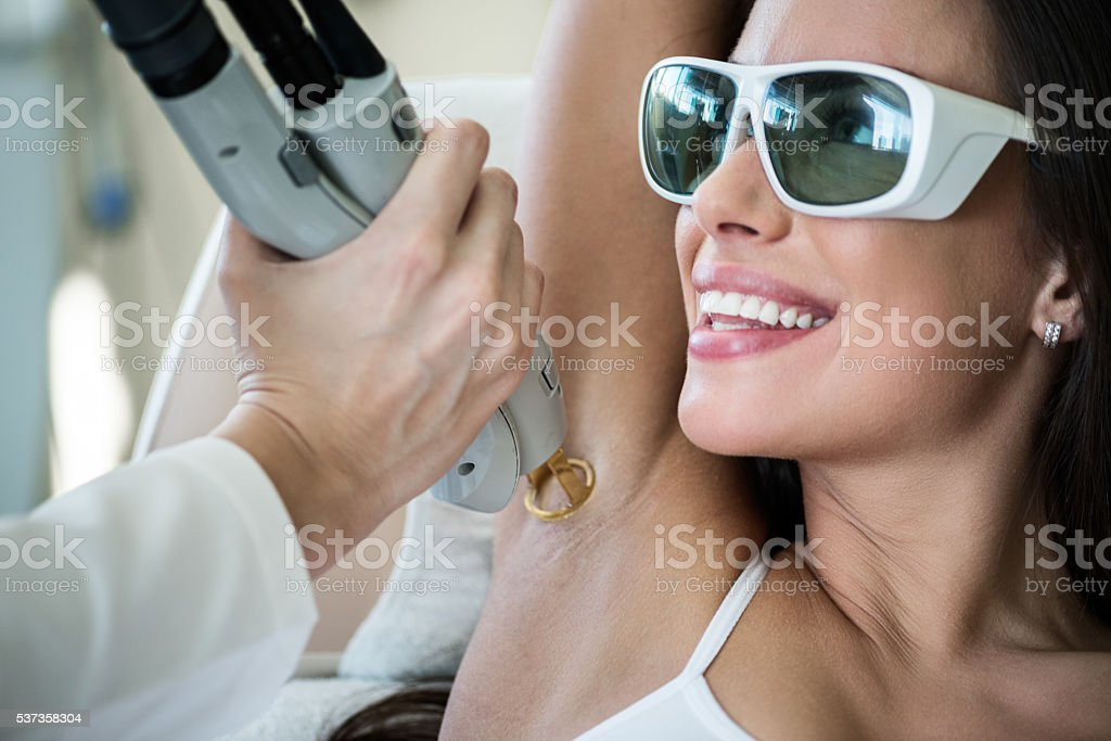 Armpit epilation treatment stock photo