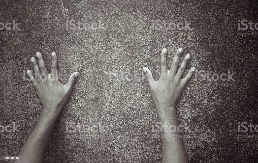 arms and hands spread against dirty grunge wall stock photo