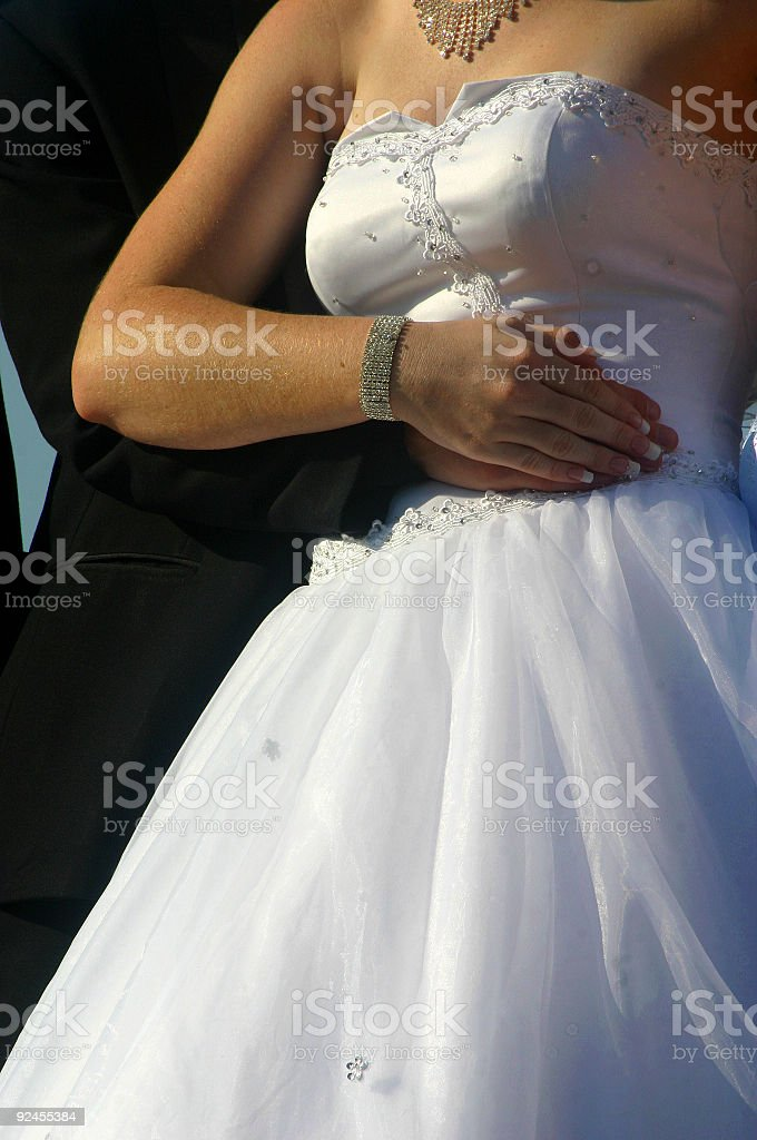 arms around a wedding royalty-free stock photo