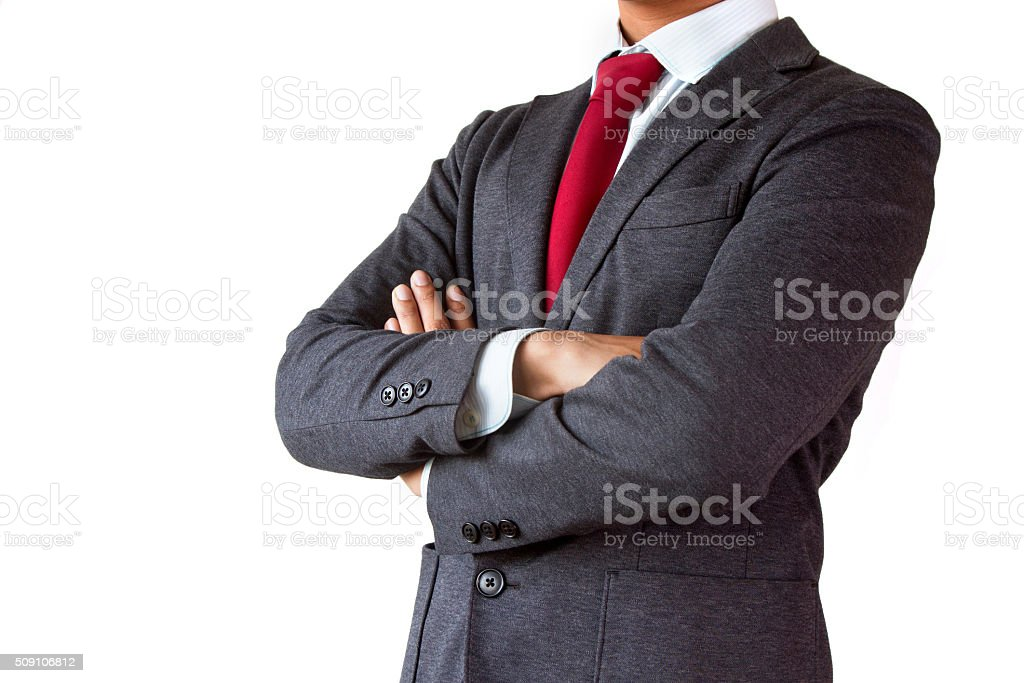 arms crossed confident young businessman isolated white background stock photo