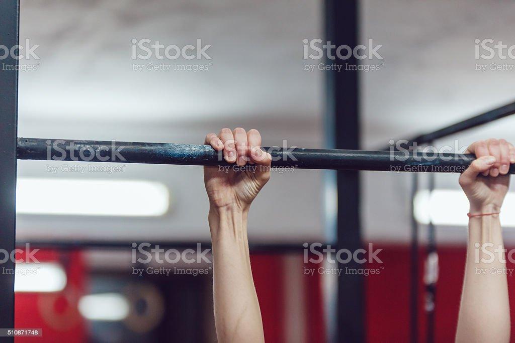 Arms. Horizontal bar. Close-up. stock photo