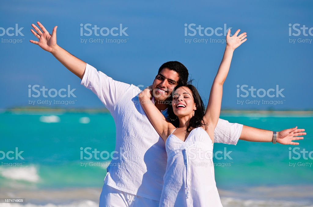 Embraced engaged couple having fun on a Tropical turquoise island...