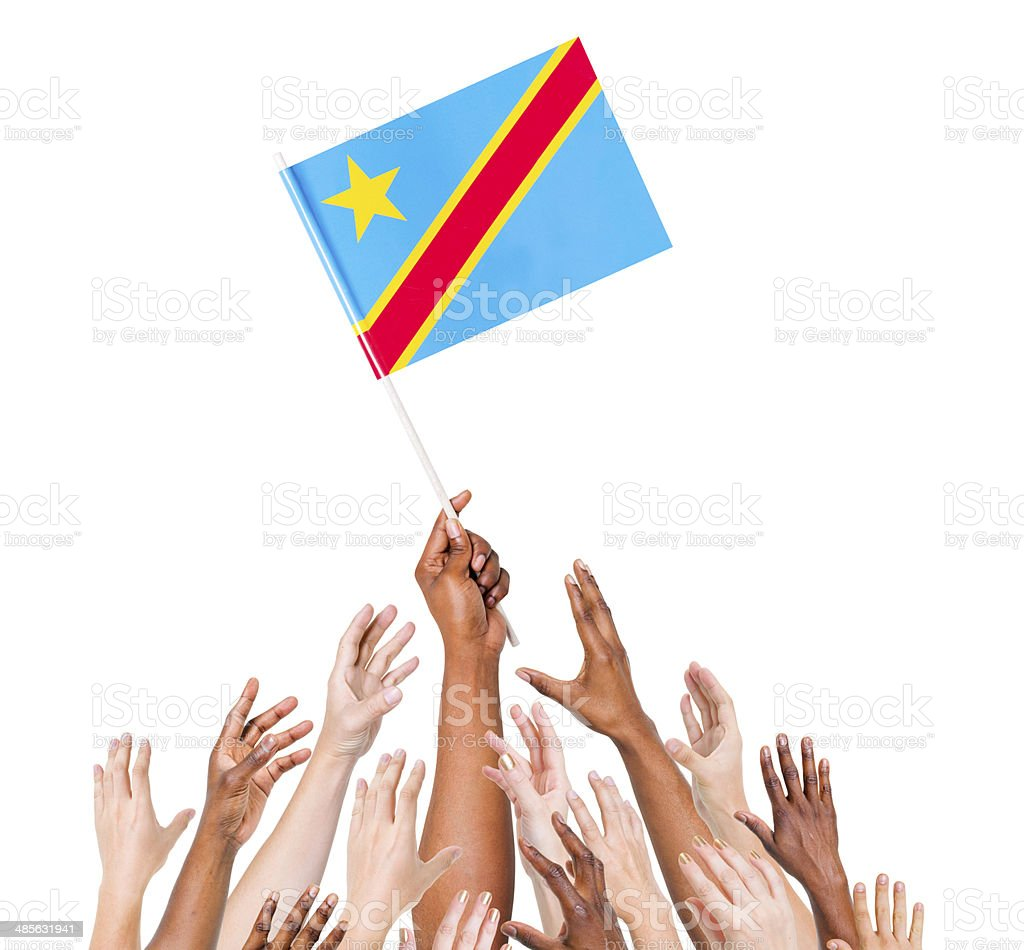 Arms Raised for the Flag of Democratic Republic of Congo stock photo