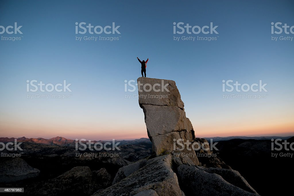 Arms raised high stock photo