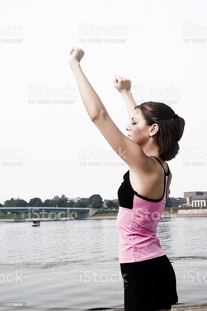 Arms raised praying to the sky stock photo