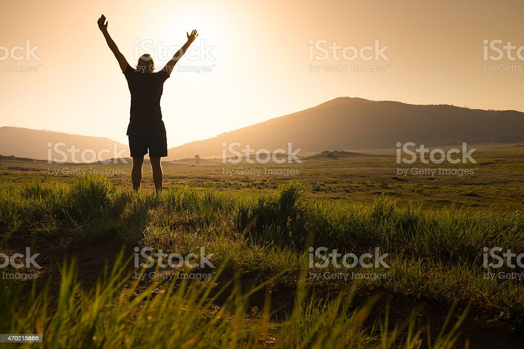 Arms Raised With Smart Phone in Hand stock photo