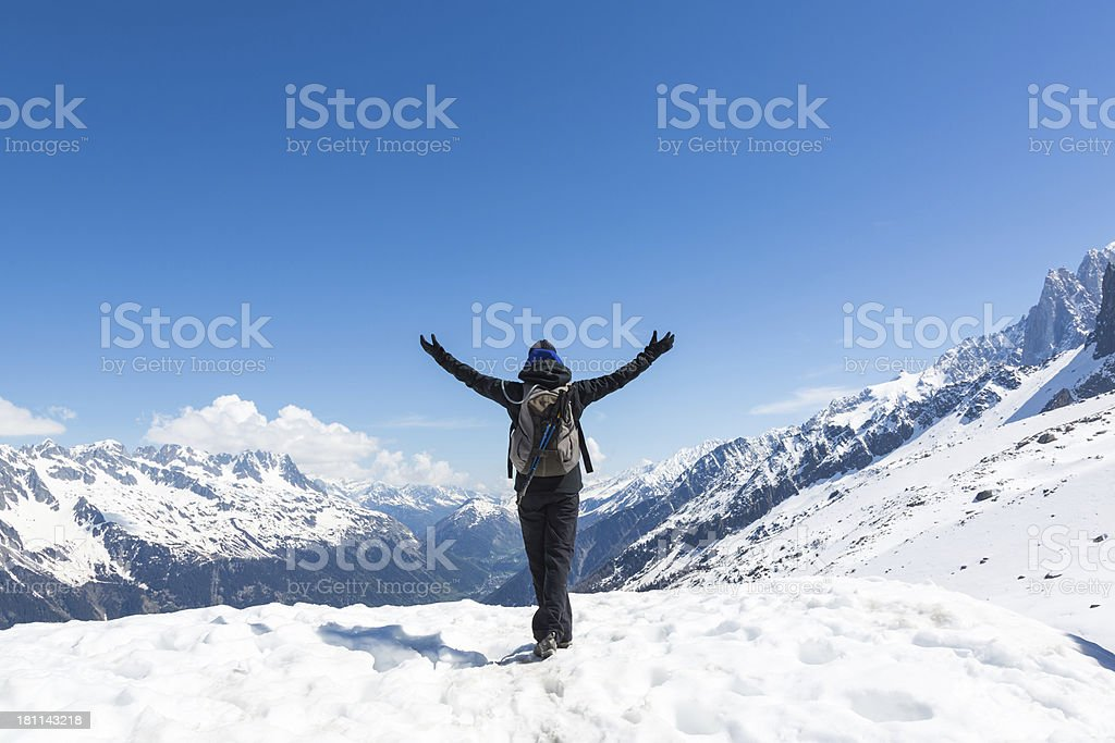 Arms Raised Woman Hiking on Mountain Summit, Chamonix, France royalty-free stock photo