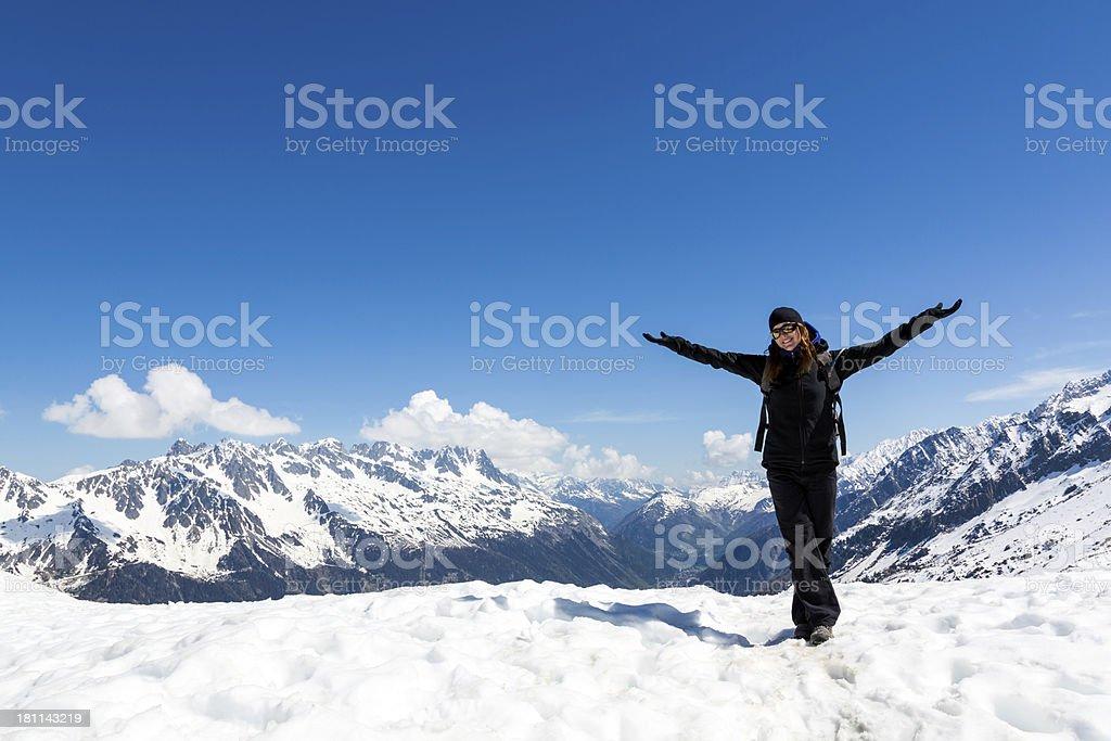 Arms Raised Woman Hiking on Mountain Summit, Chamonix, France stock photo