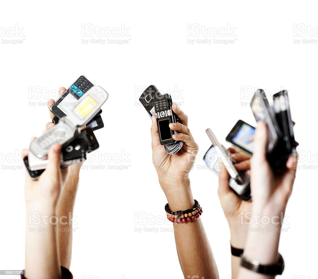 Arms with mobile phones royalty-free stock photo